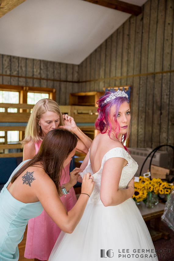 Bride getting into dress -- Camp Takodah Wedding in Richmond NH by Lee Germeroth Photography