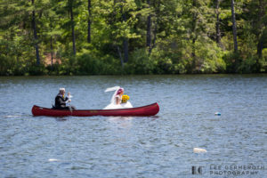 Bride in canoe -- Camp Takodah Wedding in Richmond NH by Lee Germeroth Photography