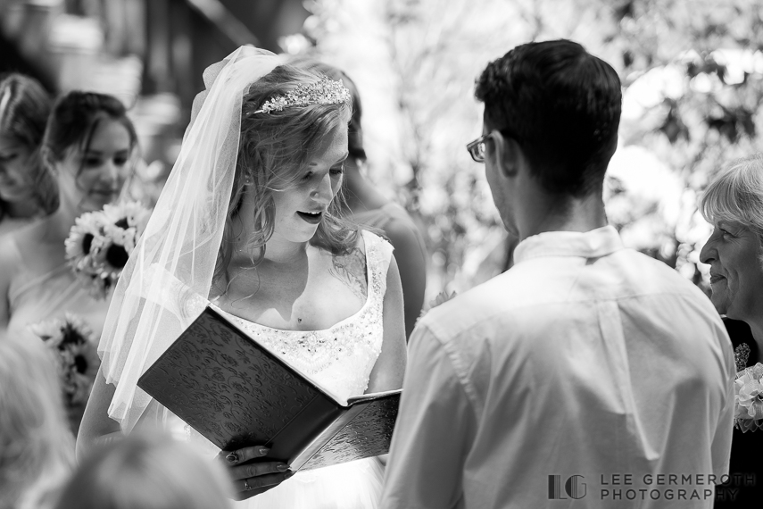 Reading ceremony vows -- Camp Takodah Wedding in Richmond NH by Lee Germeroth Photography