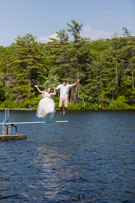 Bride and groom jumping into lake -- Camp Takodah Wedding in Richmond NH by Lee Germeroth Photography