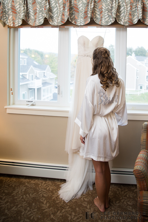Bride looking at dress -- Mount Ascutney Resort Wedding by Lee Germeroth Photography