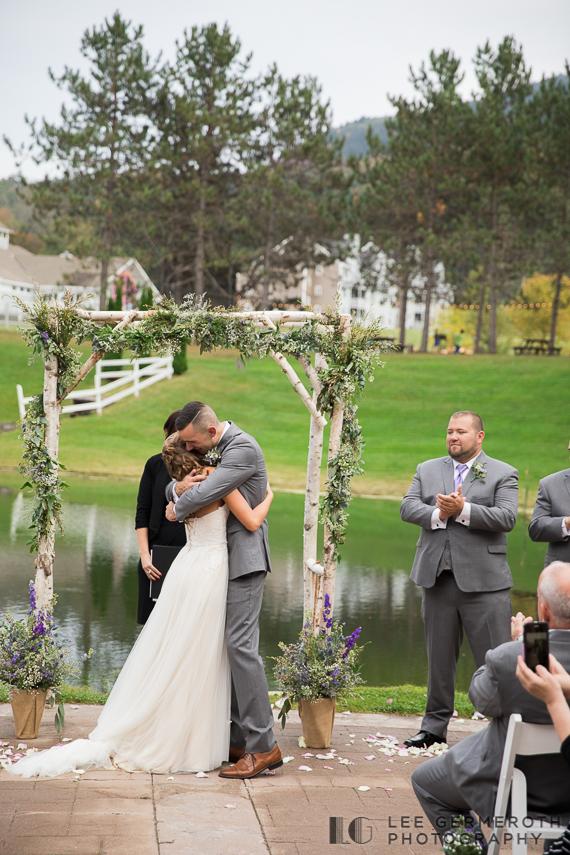 Bride and Groom hug after ceremony -- Mount Ascutney Resort Wedding by Lee Germeroth Photography