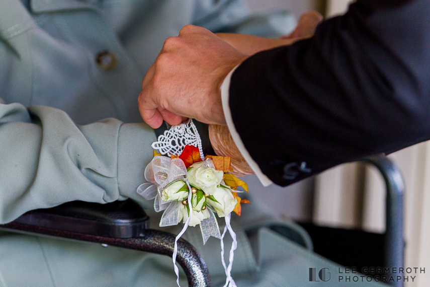 Pinning boutonniere on Grandmother - New Hampshire Country Club Wedding by Lee Germeroth Photography