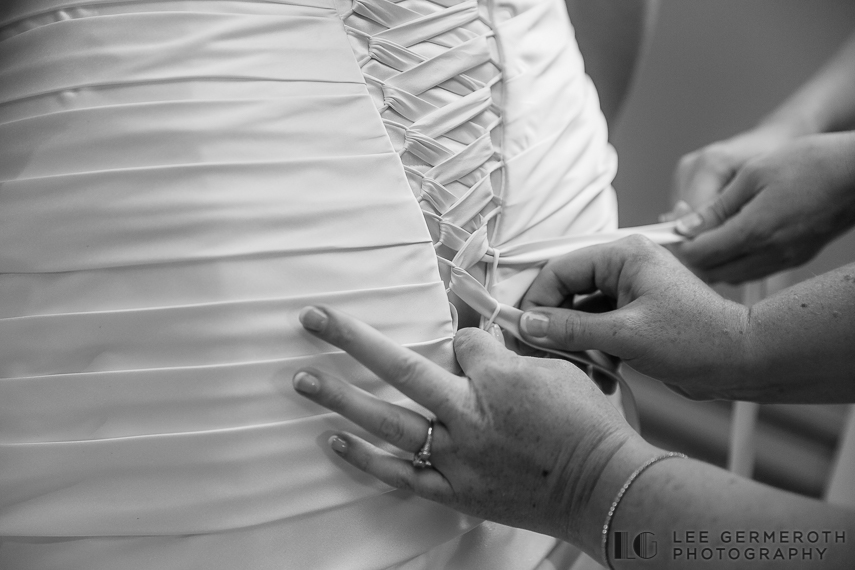 Bride putting on dress - Walpole New Hampshire Wedding by Lee Germeroth Photography